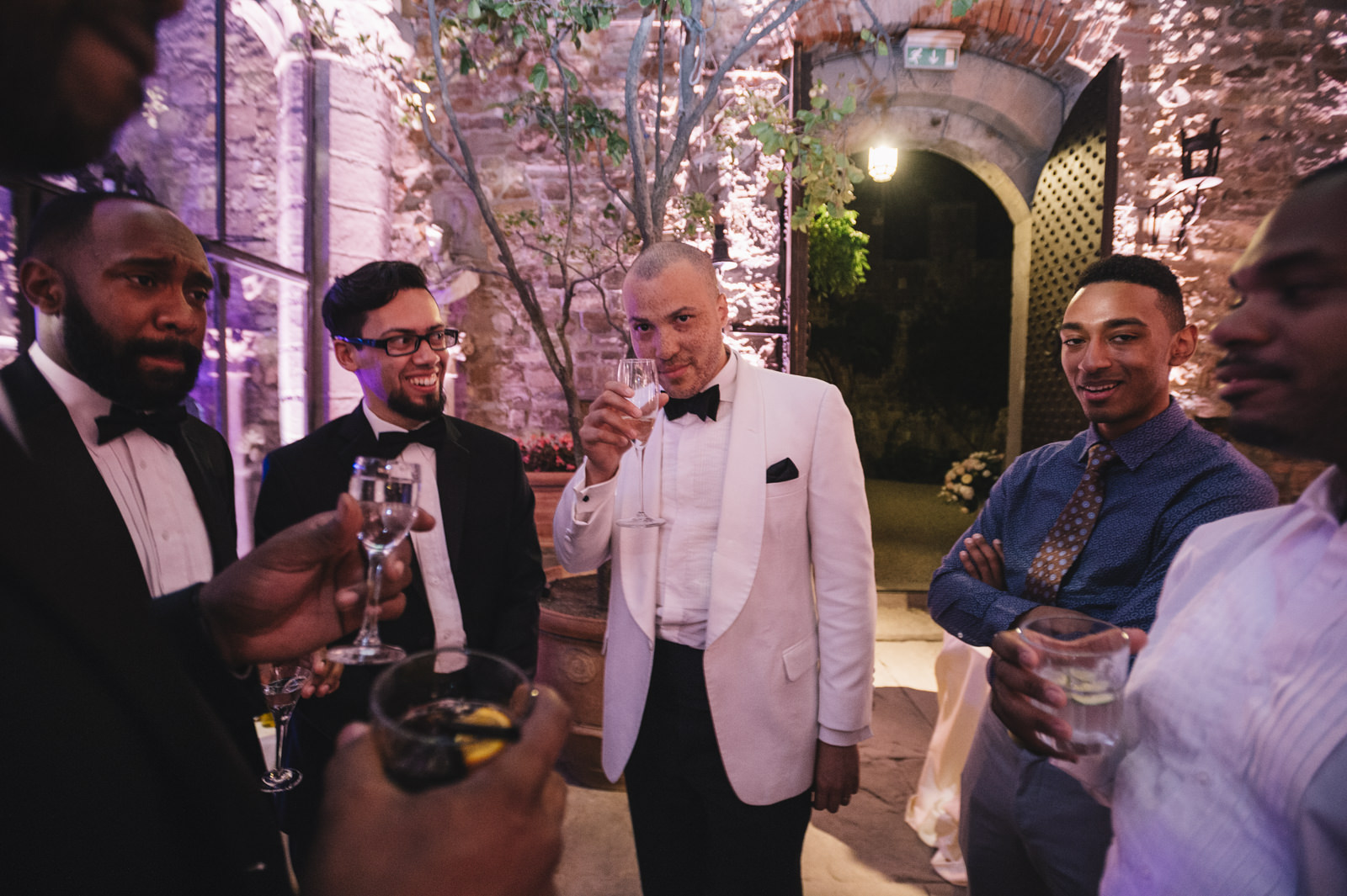 the groom with other guests during the after dinner party