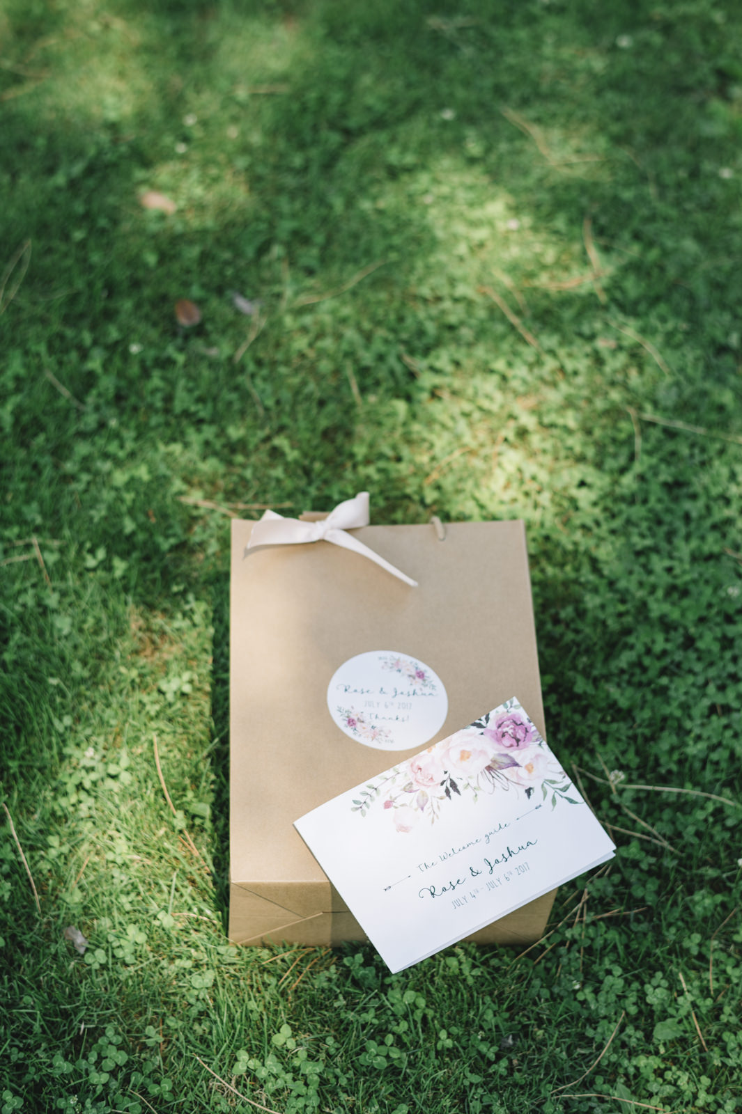 wedding invitation on green grass