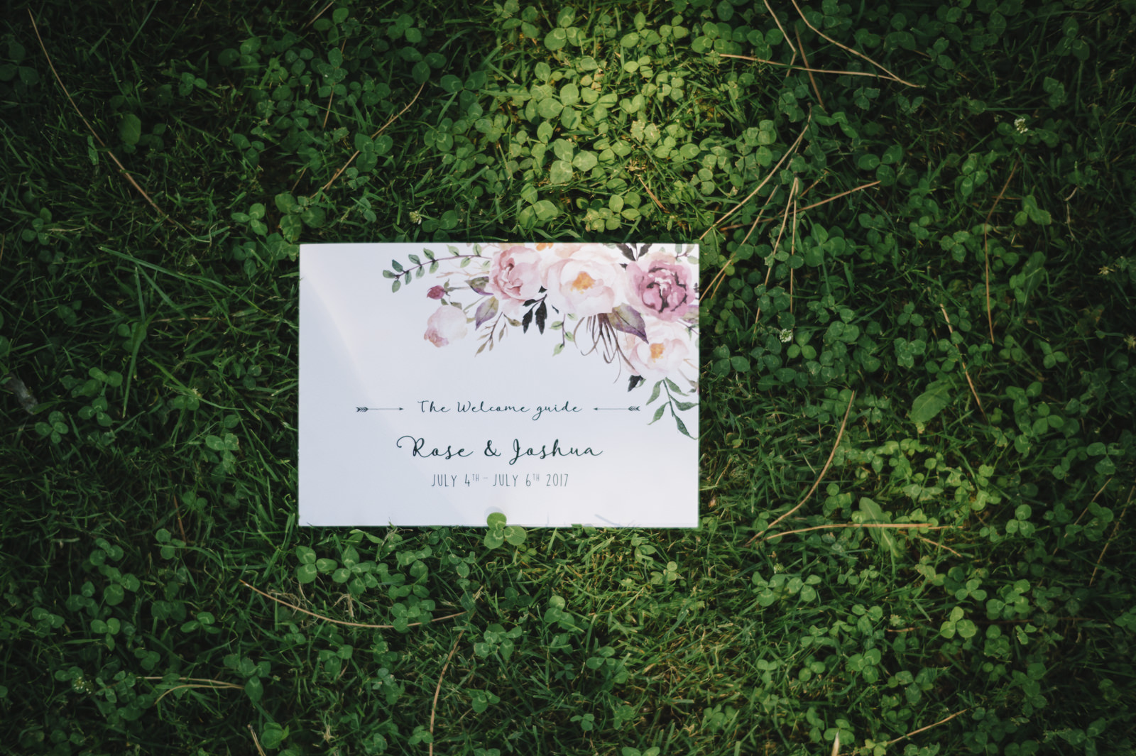 wedding invitation on the green grass