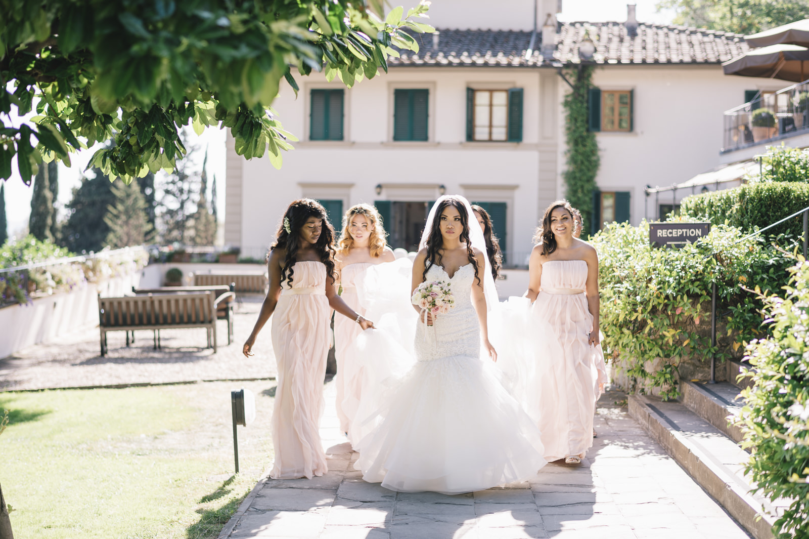 the bride and the bridesmaids walking
