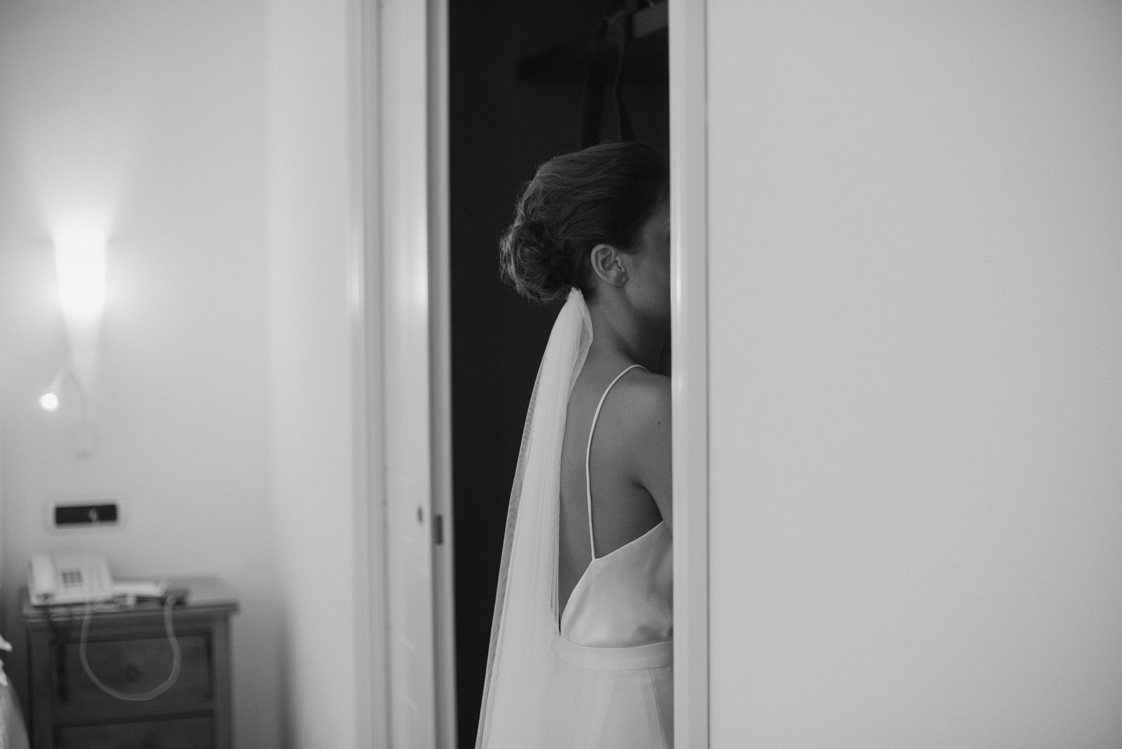 the bride during the preparation in black and white