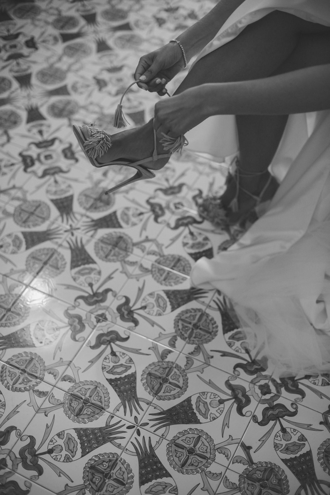 the bride wearing her shoes in black and white