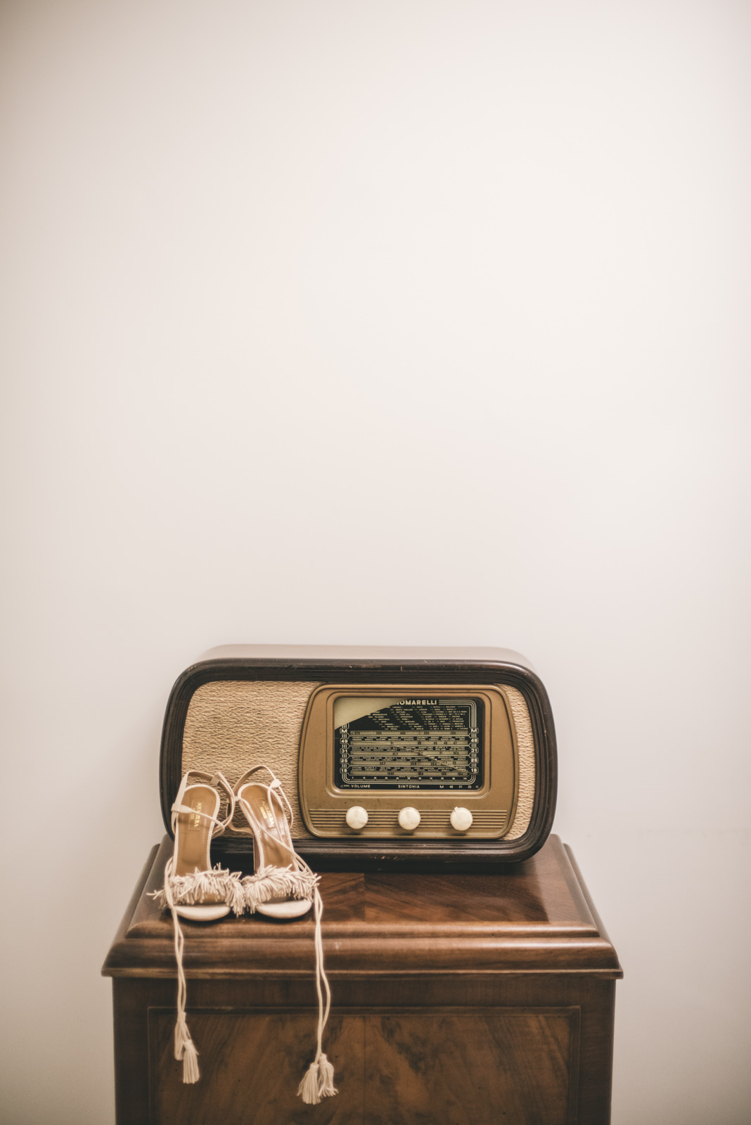 bride's shoes next to an old radio