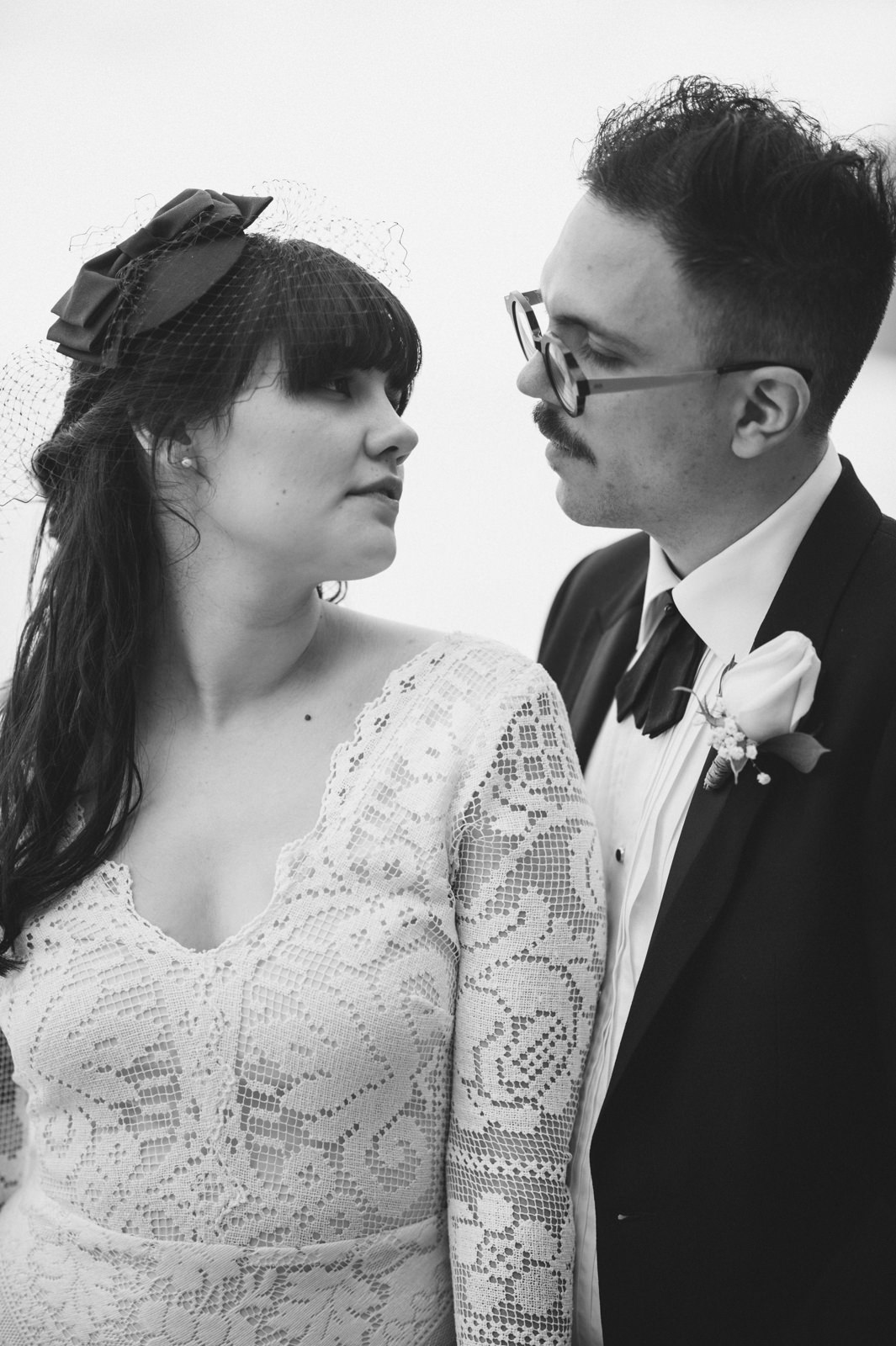 black and white portrait of the bride and the groom looking at each other