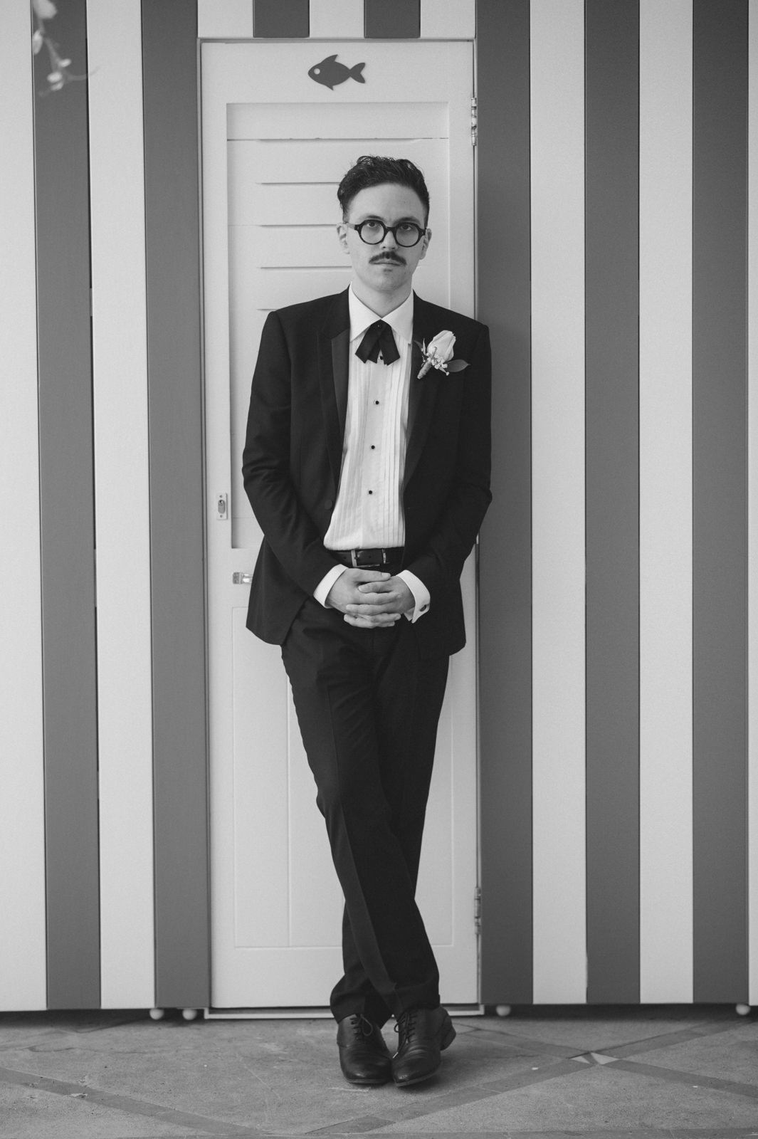 black and white portrait of the groom