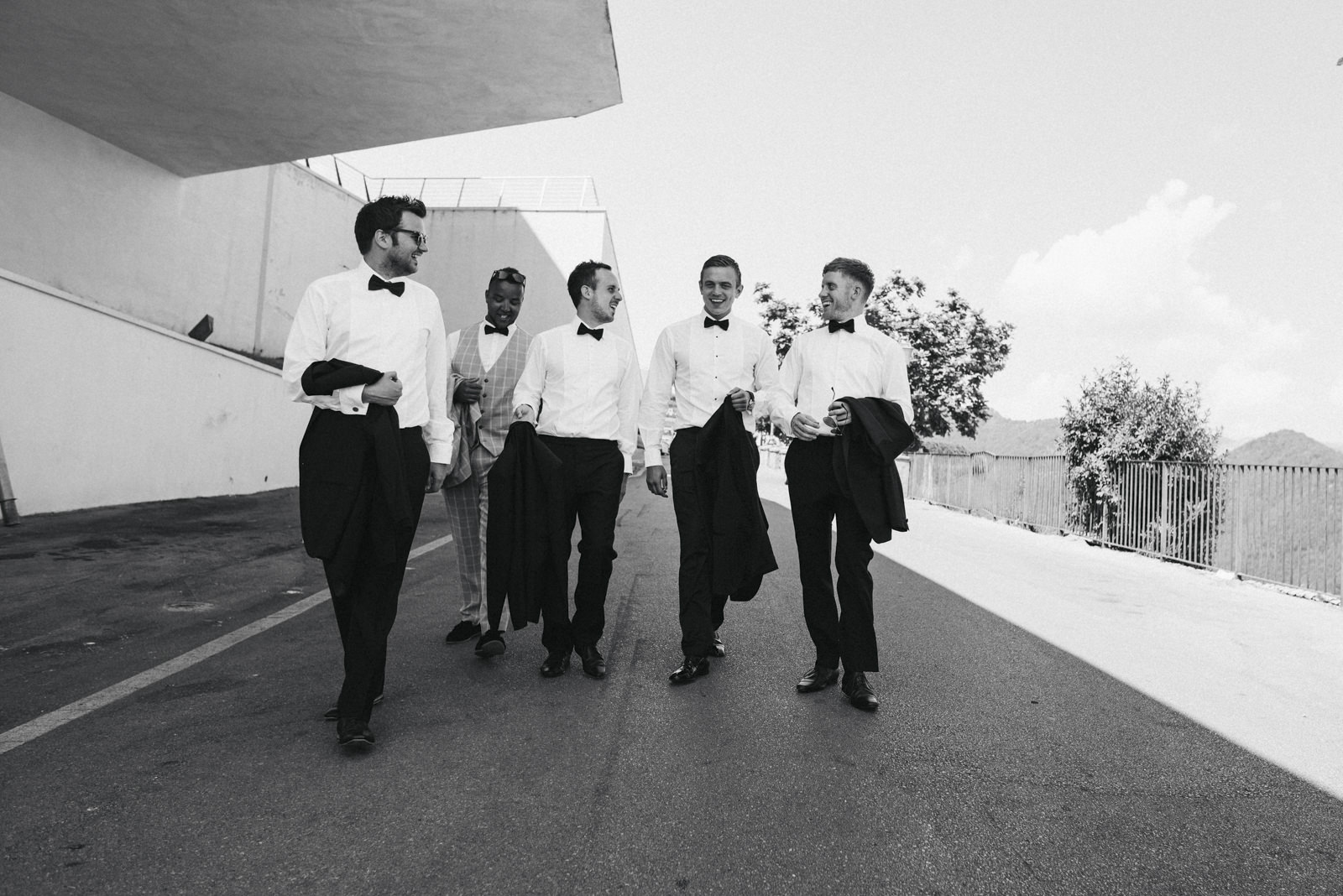 the groom walking with his best men in black and white