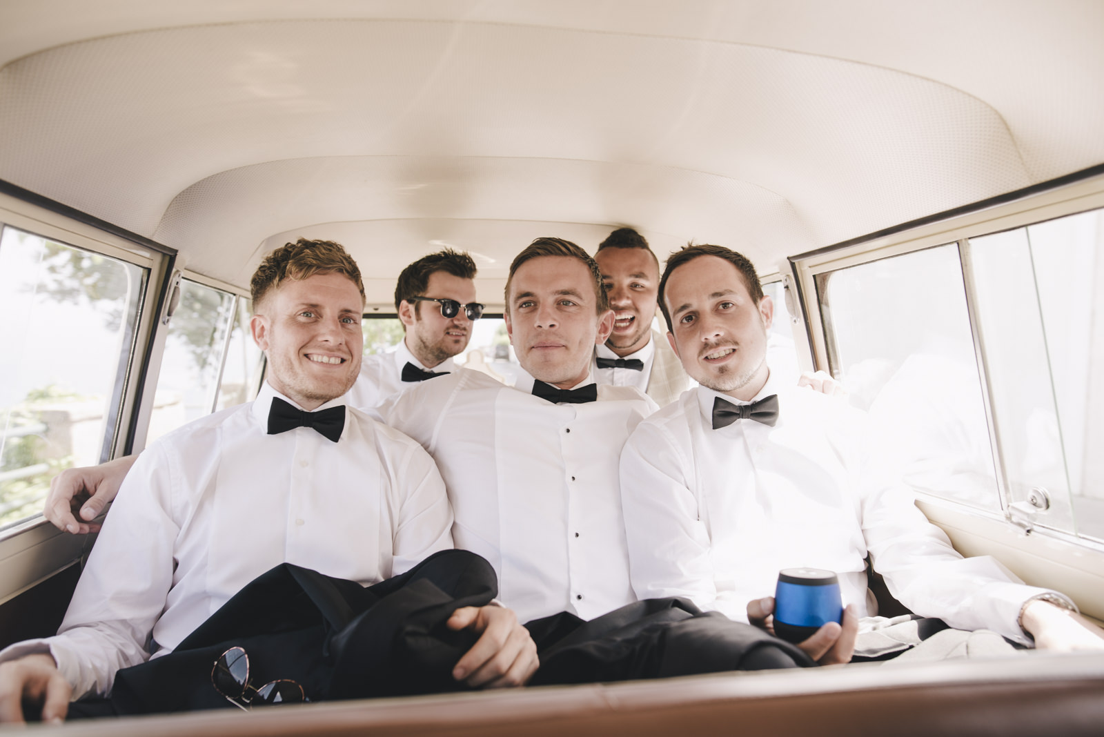 the groom with his best men in the mini van going to the ceremony