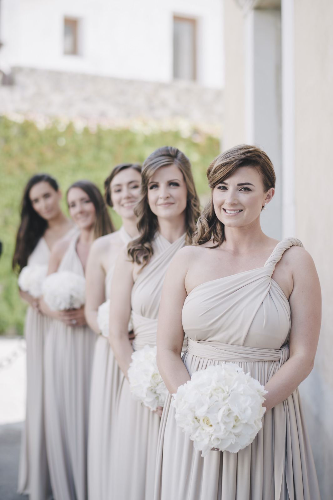 the bridesmaids outside the church