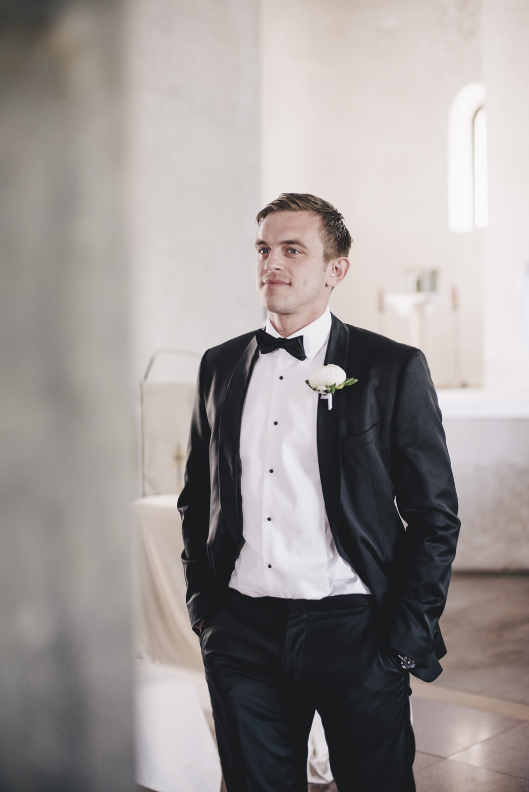 candid portrait of the groom inside the church