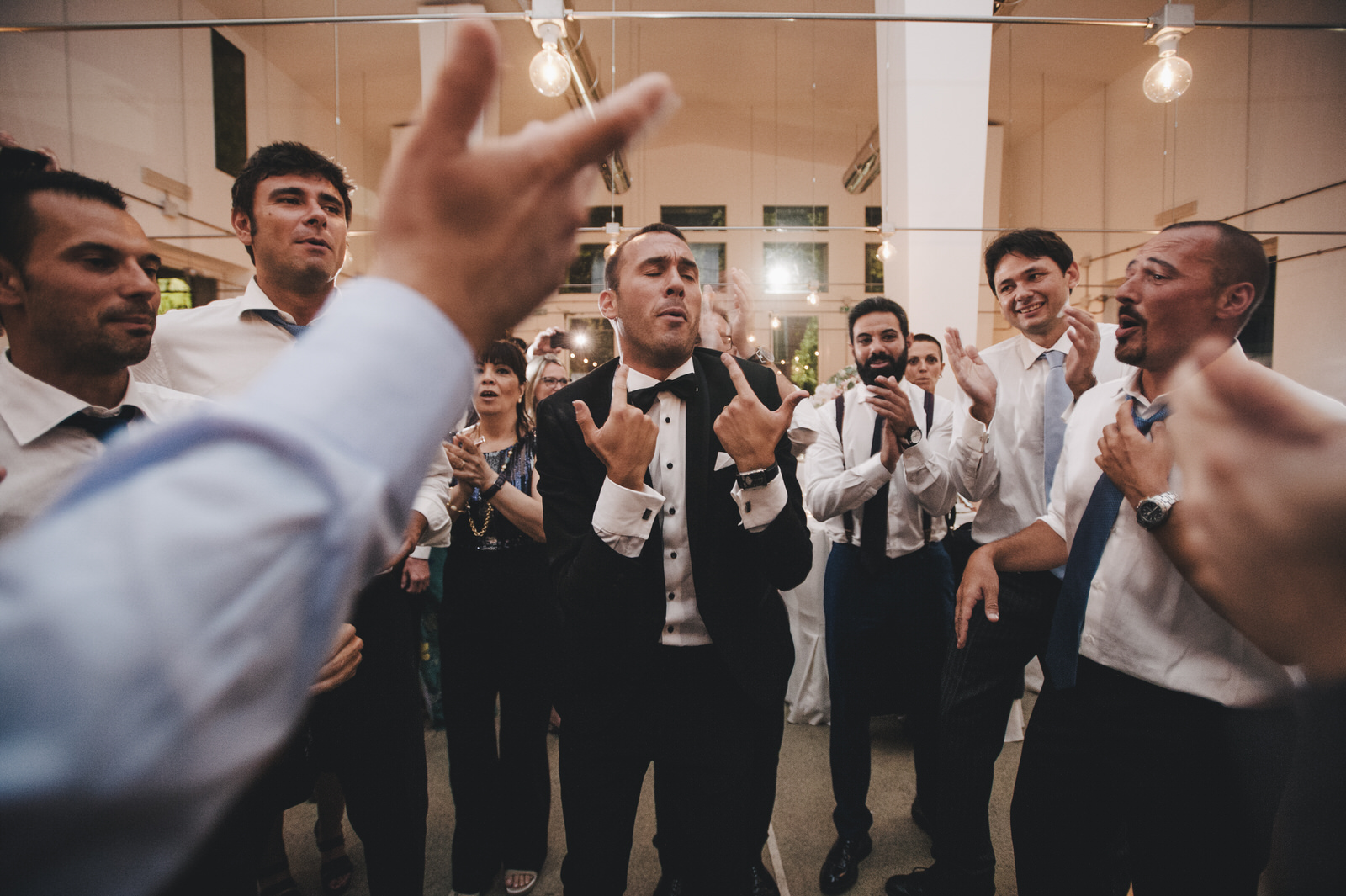 the groom dancing with his friends