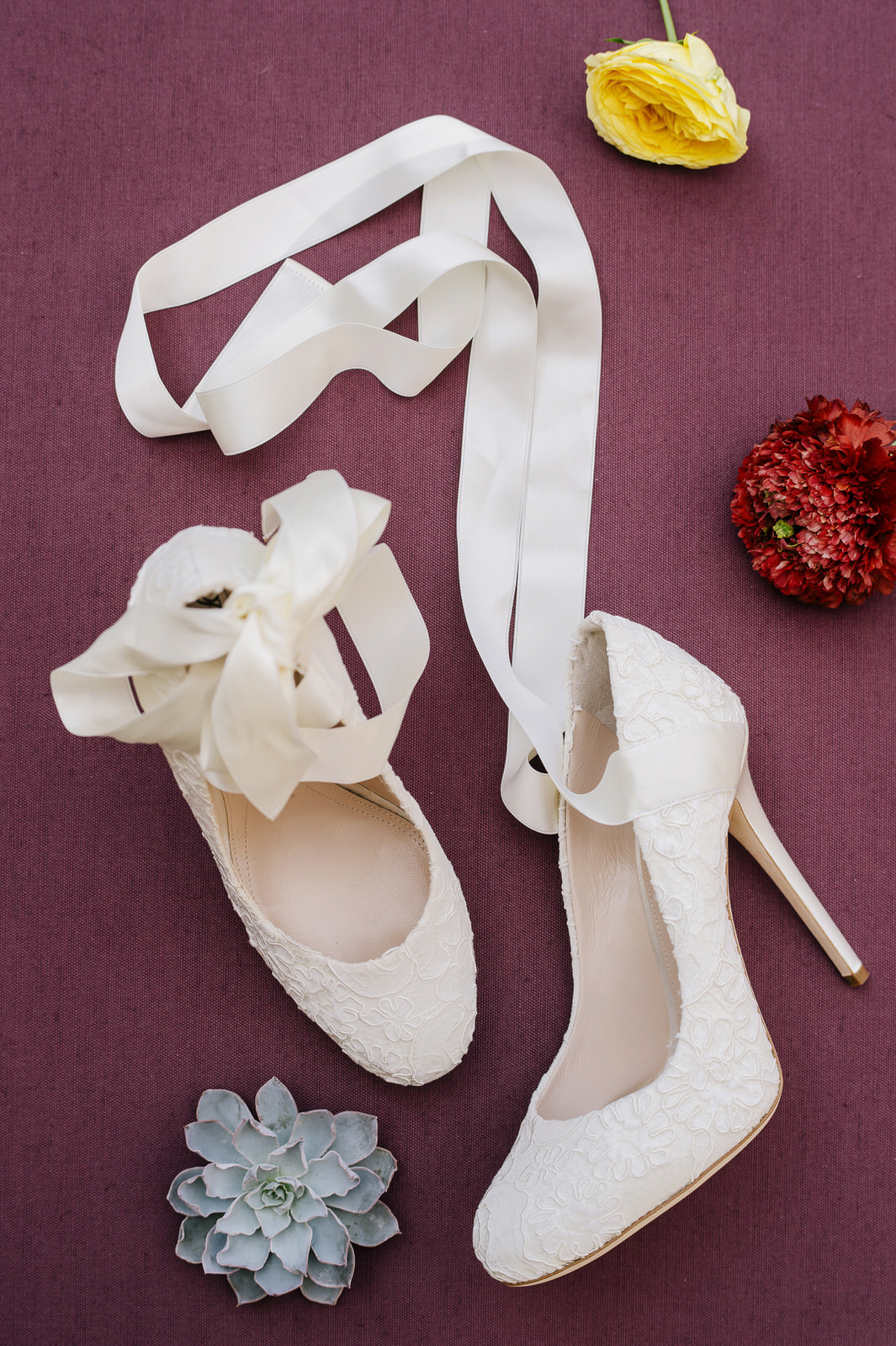 bridal shoes with yellow and red flowers