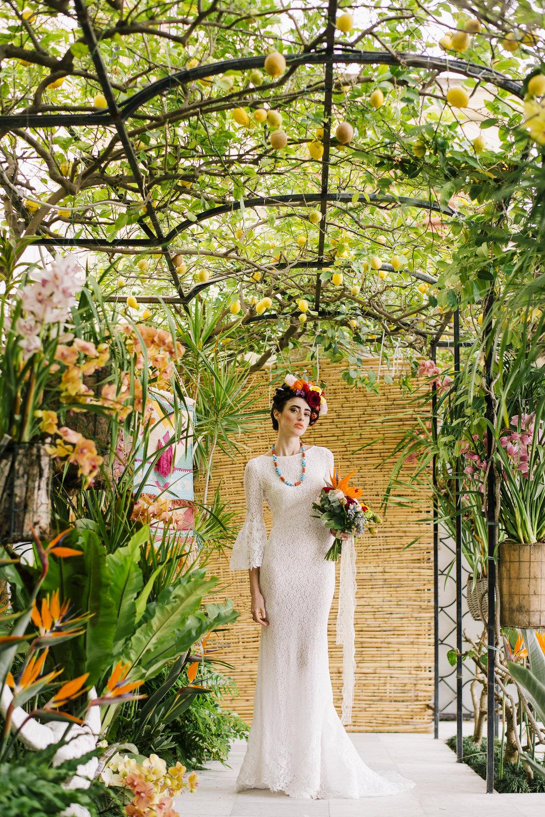 bride's portrait standing iwht her bouquet