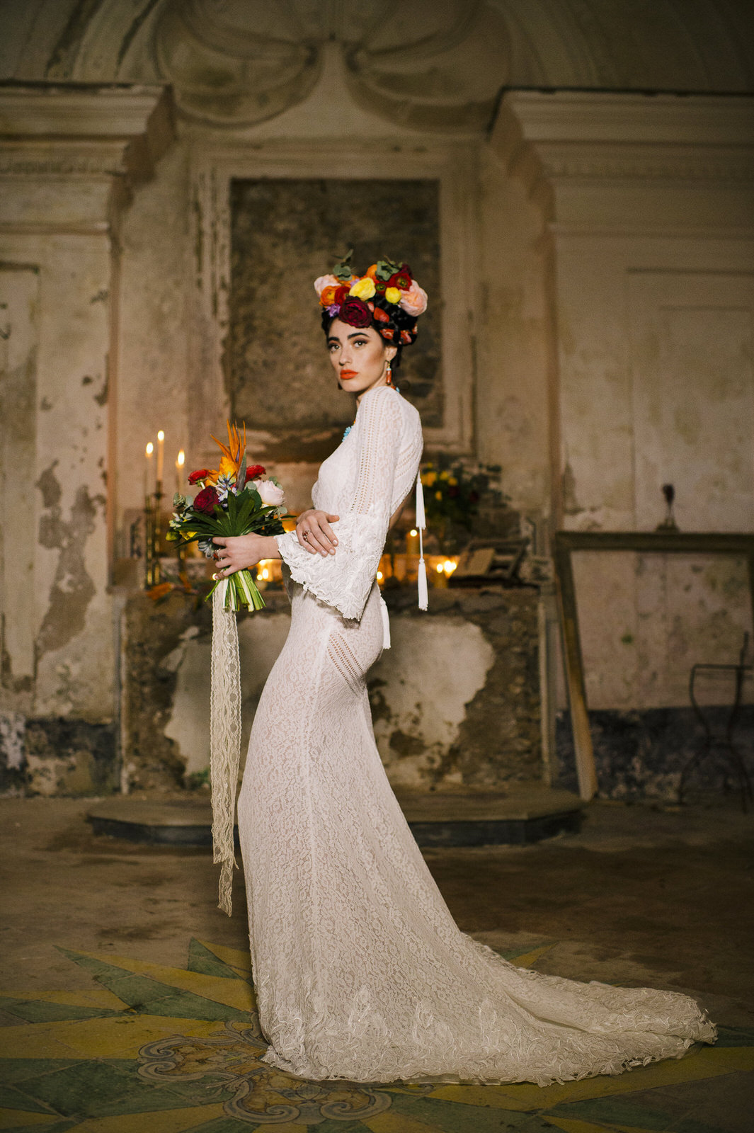 bride's standing inside the church with her bouquet