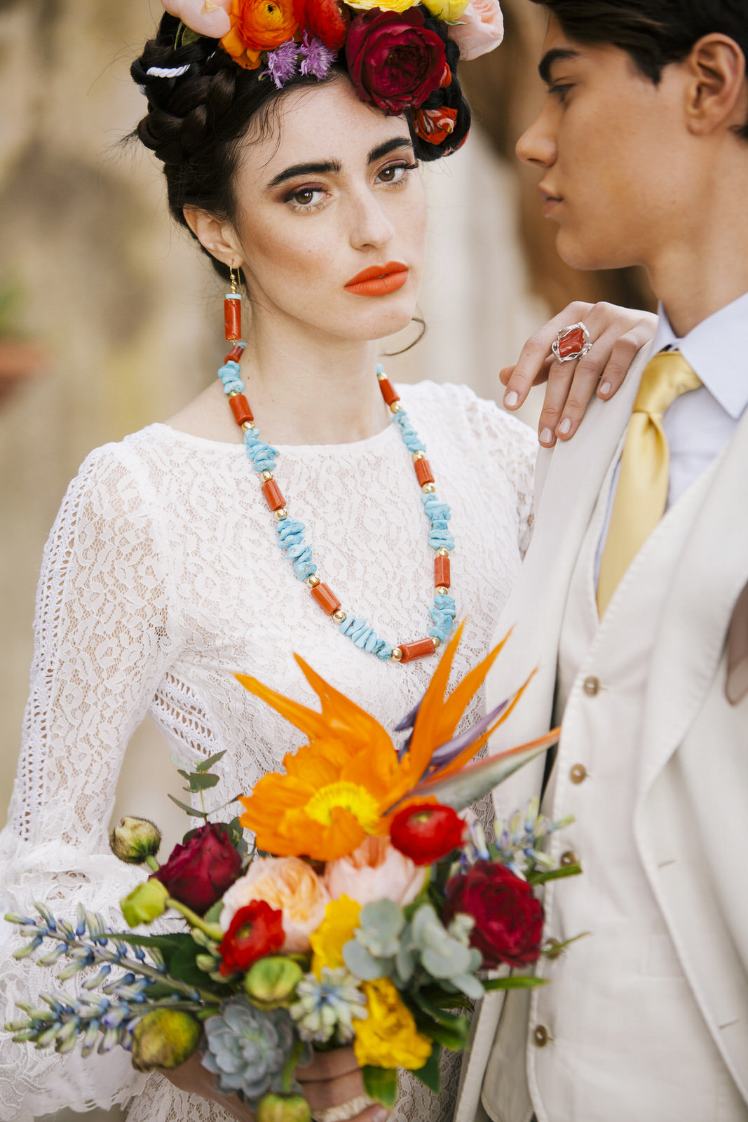 bride and groom's portrait with a colorful bouquet