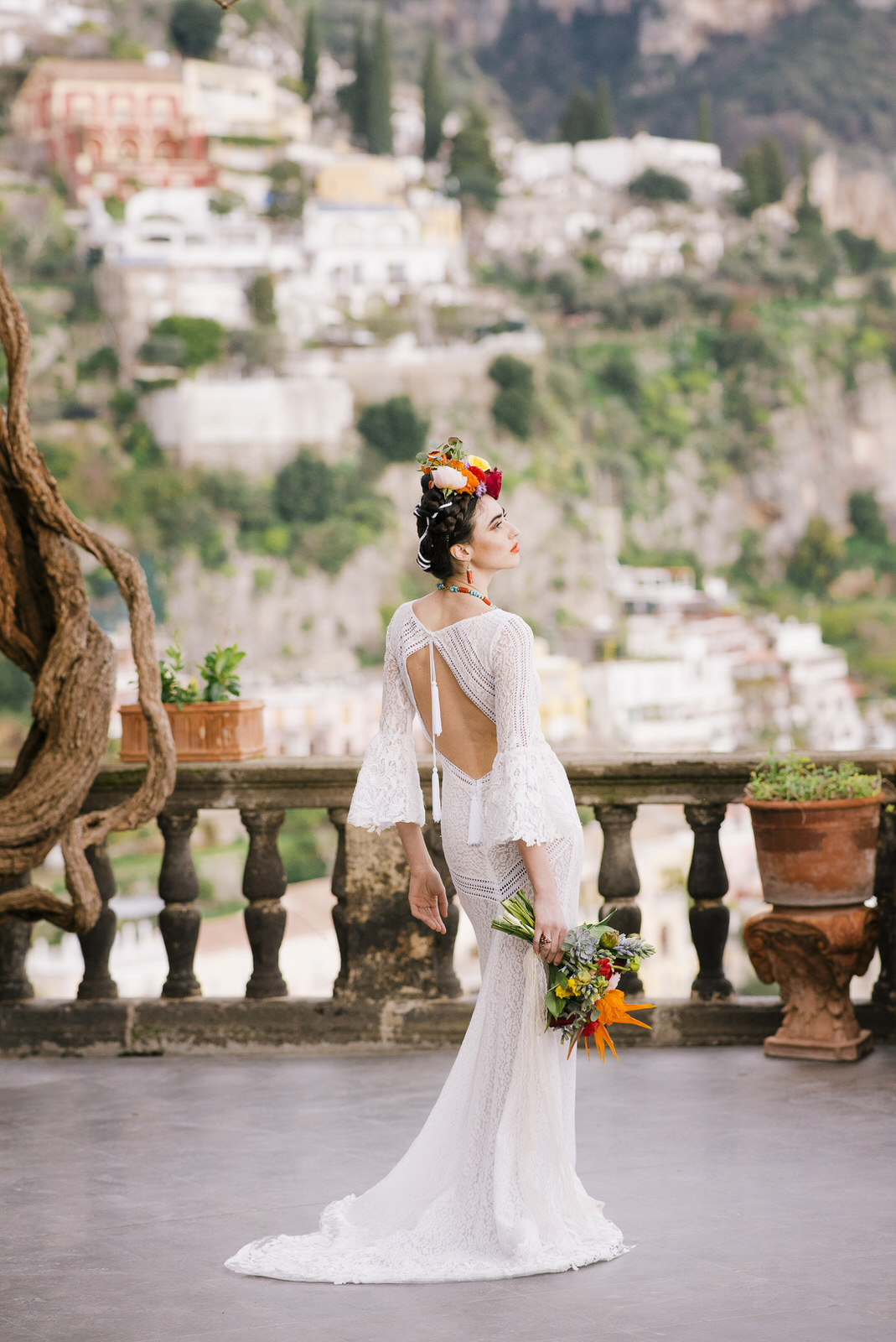 bride's portrait on a terrace with her bouquet