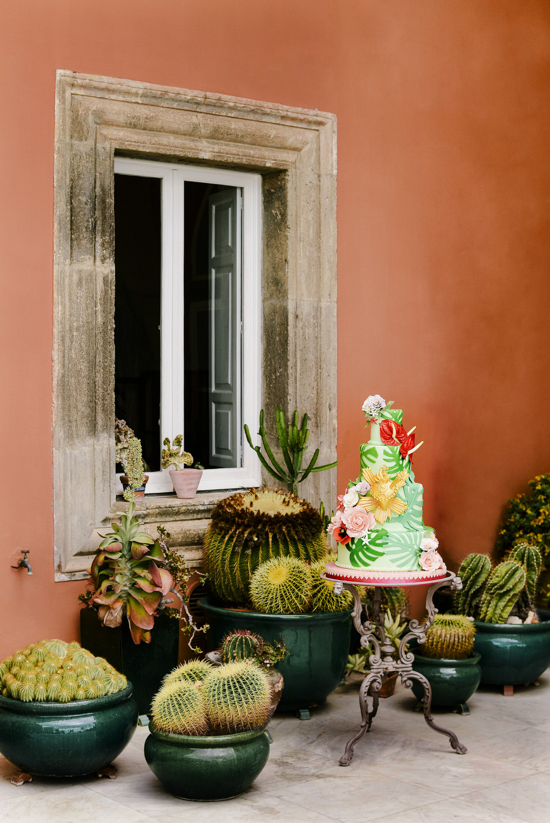 frida inspired wedding cake among cactus