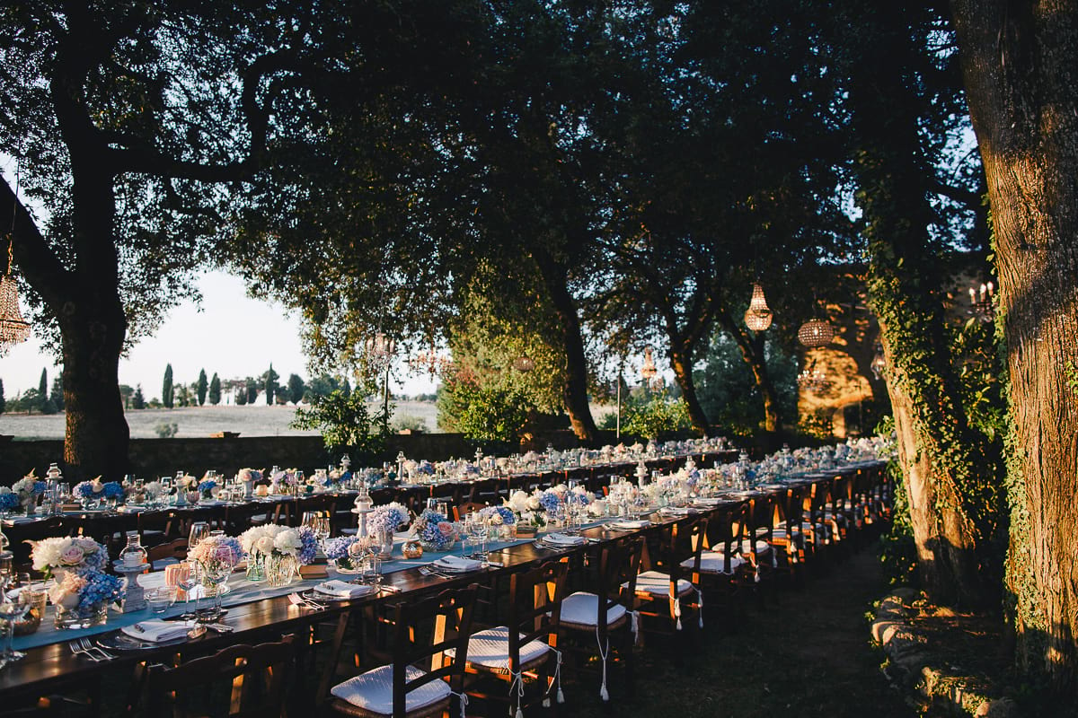 Family style dinner set up for a wedding reception in Tuscany, Italy